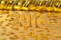 figuras de oro de 2016 años y de estrellas de oro Foto de archivo libre de regalías