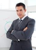 Figuras de ventas jovenes de la información del hombre de negocios imagenes de archivo