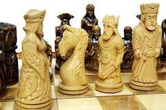 Figuras del ajedrez a bordo Foto de archivo libre de regalías
