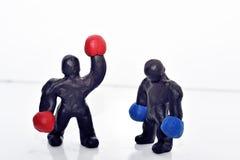 Figuras del boxeo del plasticine Imagenes de archivo