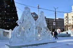 Figuras del hielo de la Navidad en el cuadrado fotos de archivo libres de regalías