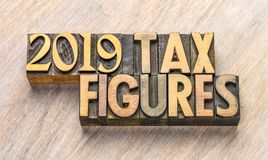 2019 figuras del impuesto en el tipo de madera imagen de archivo libre de regalías