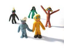 Figuras dos povos do Plasticine que dizem olá! fotografia de stock royalty free