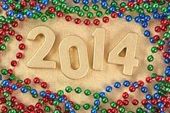 figuras douradas de 2014 anos Imagem de Stock Royalty Free