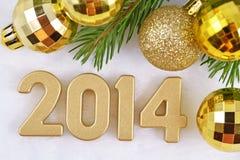 figuras douradas de 2014 anos Foto de Stock