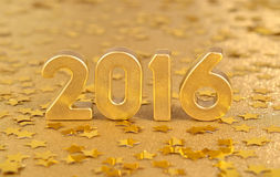 figuras douradas de 2016 anos e de estrelas douradas Imagem de Stock Royalty Free