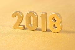 figuras douradas de 2018 anos em um dourado Imagens de Stock Royalty Free