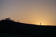 Figuras en la puesta del sol Foto de archivo libre de regalías