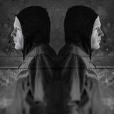 Figuras encapuchadas gemelas Imagen de archivo libre de regalías