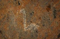 Figuras gravadas em uma superfície da pedra Foto de Stock Royalty Free