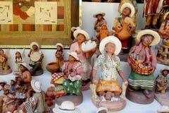 Figuras indias de los hombres del recuerdo con actividades Foto de archivo libre de regalías