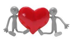 Figuras miniatura con el corazón del amor Imágenes de archivo libres de regalías