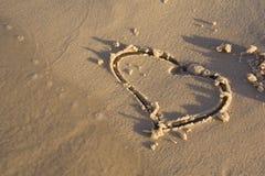 Figuras na areia Foto de Stock Royalty Free