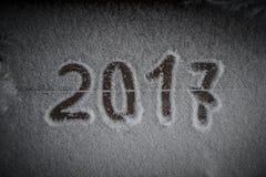 Figuras 2017 na neve Tema do ano novo e do Natal toned Fotografia de Stock