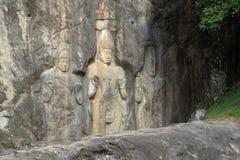 3 figuras talladas Foto de archivo