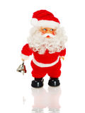 Figure. Santa Claus figurine holding bell, on white royalty free stock photos