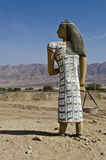Figure of ancient Egyptian woman in desert, Israel. The shot was taken at entrance to Timna National geological and historical park, 25 km from Eilat, Israel Royalty Free Stock Photo