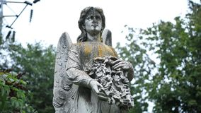 Figure of angel as symbol of sorrow at graveyard Royalty Free Stock Photos