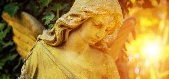 The figure of an angel in a golden glow. Symbol of love, invisib royalty free stock photography