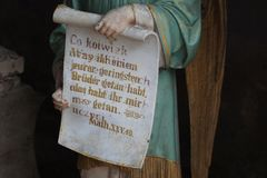 Figure of an angel holding a scroll with one of Jesus parables royalty free stock photography