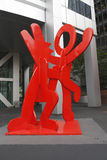 Figure balancing on dog by Kieth Haring in Manhattan Stock Images