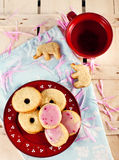 Figure biscuits and tea. On board Stock Photos