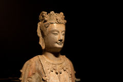 Figure of the Buddha. Buddha isolated on a dark background Royalty Free Stock Images