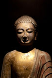 Figure of the Buddha. Buddha isolated on a dark background Stock Photos