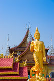 Figure of Buddha and Buddhist palace Stock Photography