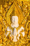 Figure of buddhist angel in a temple. Figure of buddhist angel on the wall Royalty Free Stock Photos