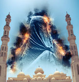 Figure in Burqa in Sky Above El Mina Masjid Mosque Stock Image