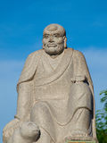 Figure of chinese god with blue sky Stock Photography
