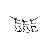 Figure christmas boots hanging on a rope Royalty Free Stock Images