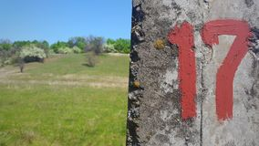 Figure 17 on the concrete with a blurred background of nature Royalty Free Stock Photo