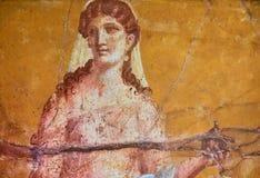 Figure d'une femme peinte dans un fresque dans un Domus de Pompeii photo libre de droits
