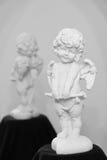 Figure de cupidon avec la réflexion Photographie stock