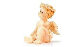 Figure de l'ange se reposant sur un fond blanc images stock