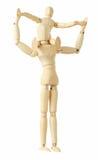 Figure di legno del bambino che si siedono sul collo del genitore Fotografia Stock