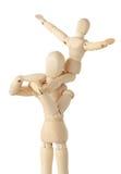 Figure di legno del bambino che si siedono sul collo del genitore Fotografie Stock
