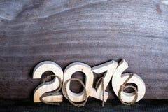 Figure di legno 2016 della luce e della corda su fondo di legno grigio dentro Immagine Stock Libera da Diritti