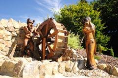 Figure di legno intagliate a grandezza naturale Fotografia Stock