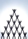 Figure di modello che formano piramide Fotografia Stock Libera da Diritti