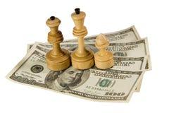 Figure di scacchi sui dollari US Fotografia Stock Libera da Diritti