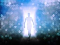 Figure in door way. Of light Stock Photography
