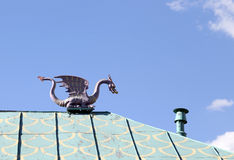 The figure of a dragon on the roof. Stock Photos