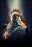 Figure Dressed in Flaming Burqa Royalty Free Stock Image