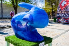 Figure of Easter bunny in psychedelic blue color with painted blue mushrooms on it. Beautiful Easter art decoration .Kyiv Kiev, royalty free stock photo