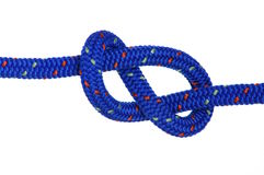 Figure eight. A blue clibing rope knotted in a figure eight Royalty Free Stock Photo