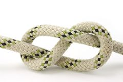 Figure-eight knot. Tied on a white rope Stock Images