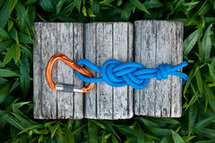 Figure eight knot with a carabiner. Climbing rope with a figure eight knot and a carabiner stock photos